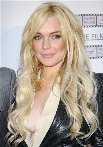 """FILE - In this April 12, 2011 file photo, actress Lindsay Lohan poses during a news conference for the film """"Gotti: Three Generations"""", based on the life of John Gotti, in New York."""