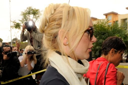 Lindsay Lohan arrives with her lawyer, Shawn Chapman Holley, right, for a preliminary hearing, Friday, April 22, 2011, at LAX Courthouse in Los Angeles.