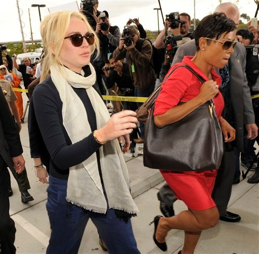Lindsay Lohan, left, arrives with her lawyer, Shawn Chapman Holley for a preliminary hearing, Friday, April 22, 2011, at LAX Courthouse in Los Angeles.