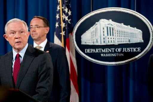 Attorney General Jeff Sessions accompanied by Deputy Attorney General Rod Rosenstein, second from left, speaks at a news conference to announce an international cybercrime enforcement action at the Department of Justice, Thursday, July 20, 2017, in Washin