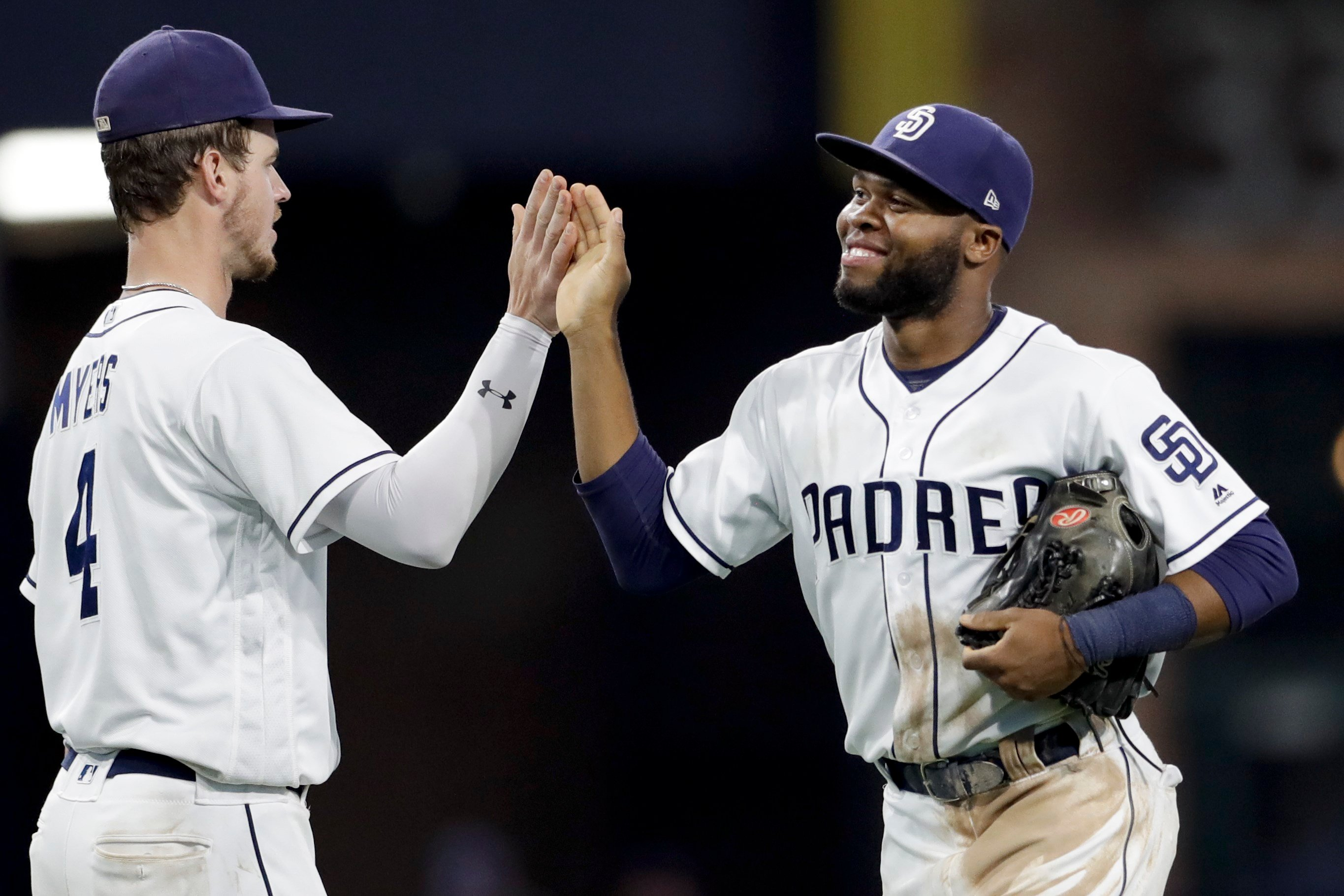 San Diego Padres center fielder Manuel Margot, right, celebrates with first baseman Wil Myers after the Padres defeated the New York Mets 7-5 in a baseball game Thursday, July 27, 2017, in San Diego. (AP Photo/Gregory Bull)