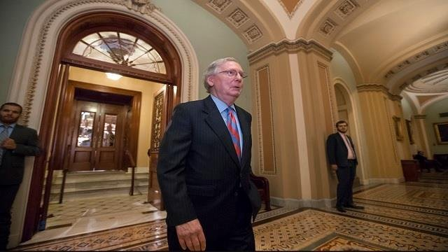 Senate Majority Leader Mitch McConnell of Ky. leaves the Senate chamber on Capitol Hill in Washington.