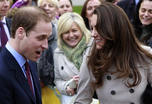 FILE - In this Tuesday, March 8, 2011 file photo, Britain's Prince William and Kate Middleton prepare to flip pancake at a display by the charity Northern Ireland Cancer Fund for Children outside the City Hall in Belfast, Northern Ireland.