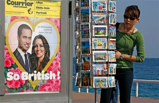 "A poster depicting Britain's Prince William and his fiancee Kate Middleton, with a headline in French reading, ""Do the British still want a king?"""