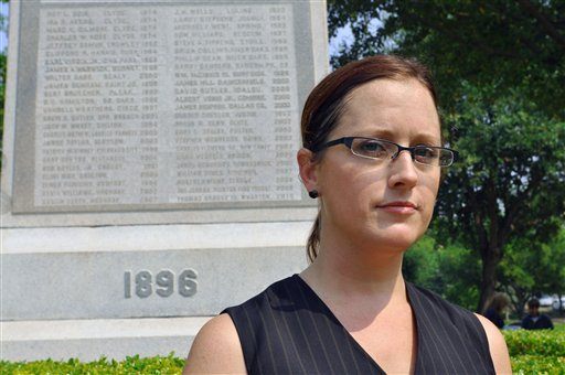 Nikki Araguz stands in front of a monument to fallen volunteer firefighters in Austin, Texas. Araguz is a transgendered woman whose husband died while fighting a fire in Wharton County in 2010. (AP Photo/ Chris Tomlinson)
