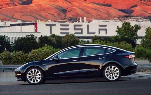 This undated image provided by Tesla Motors shows the Tesla Model 3 sedan.  (Courtesy of Tesla Motors via AP)