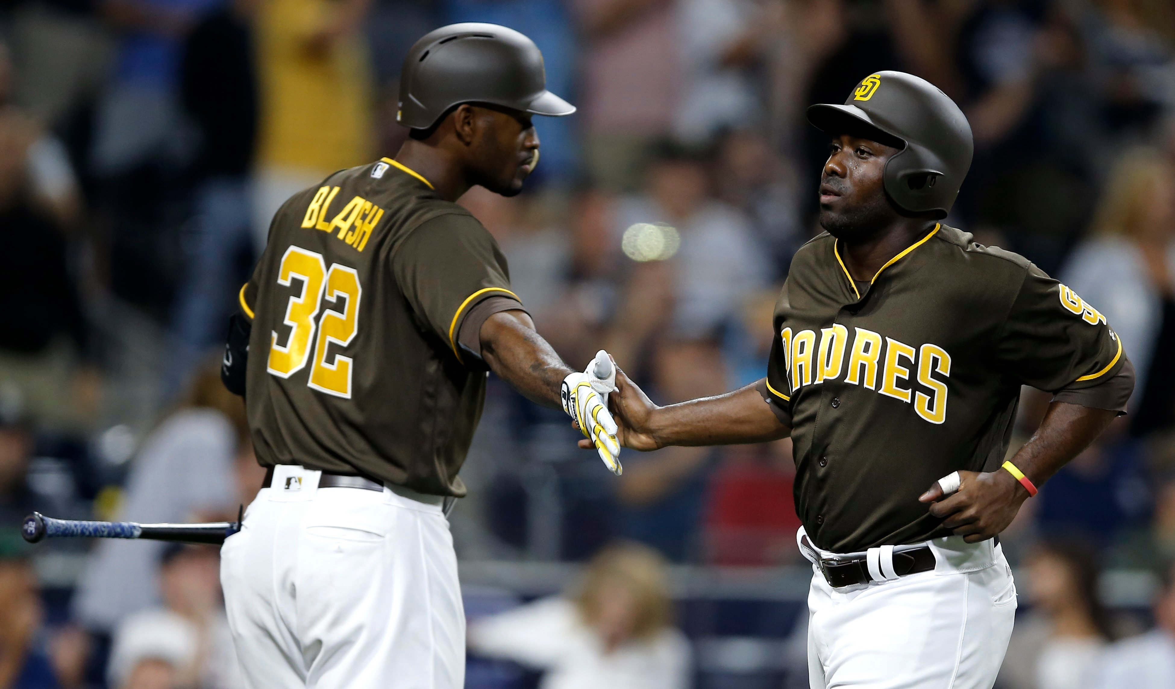 San Diego Padres' Jose Pirela, right, gets congratulations from Jabari Blash after scoring on a triple by Cory Spangenberg during the sixth inning of a baseball game against the Pittsburgh Pirates in San Diego, Friday, July 28, 2017. (AP Photo/Alex Gallar