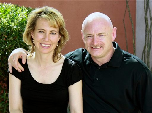 FILE - This undated file photo provided by the office of Rep. Gabrielle Giffords, shows her, left, with her husband, NASA astronaut Mark Kelly.