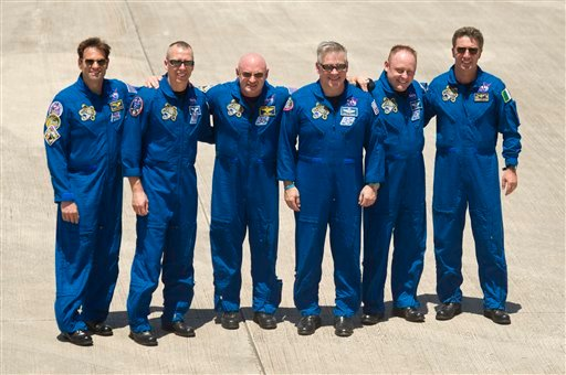 In this photo provided by NASA, STS-134 Commander Mark Kelly, third from left, along with his crew pose for a photograph following their arrival to Kennedy Space Center, Tuesday, April 26, 2011, in Cape Canaveral, Fla.