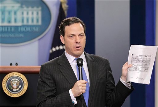 Moments before President Obama spoke on the subject, ABC News' Chief White House Correspondent Jake Tapper holds up a copy of the president's birth certificate, released by the White House, Wednesday, April 27, 2011.