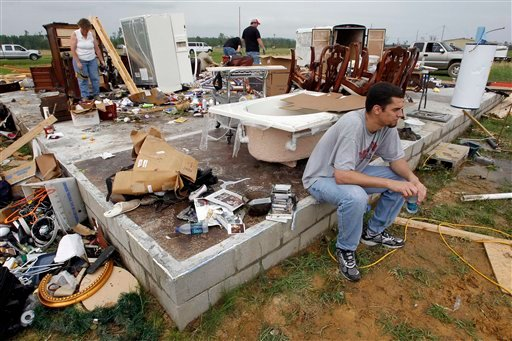 Ken Sanders, son-in-law of Jay and Carla Arendal, takes a rest while helping to look for items to keep after a tornado destroyed the Arendal's home on April 26, 2011, in Vilonia, Ark. (AP Photo/Mark Humphrey)
