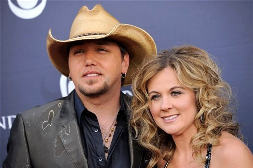 Jason Aldean, left, and Jessica Aldean arrive at the 46th Annual Academy of Country Music Awards in Las Vegas on Sunday, April 3, 2011. (AP Photo/Chris Pizzello)