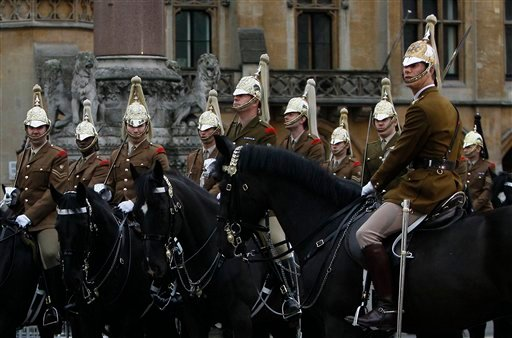 Soldiers of the Household Cavalry wait for orders outside Westminster Abbey as they take part in an overnight dress rehearsal for the Royal Wedding of Britain's Prince William and Kate Middleton, in central London, Wednesday, April, 27, 2011.