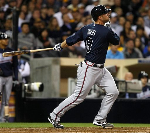 Atlanta Braves' David Ross watches his three-run home run in the sixth inning, his second homer of the night against the San Diego Padres in a baseball game Tuesday, April 26, 2011, in San Diego. (AP Photo/Lenny Ignelzi)