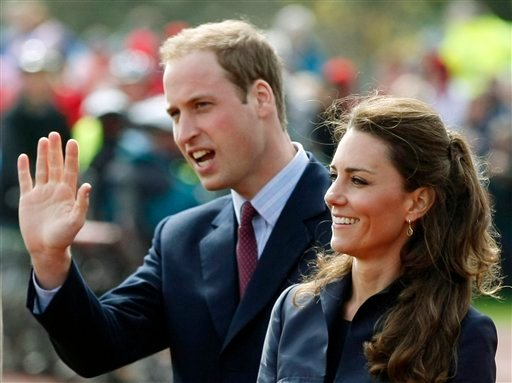 FILE - This Monday April 11, 2011 file photo shows Britain's Prince William accompanied by his fiancee Kate Middleton, as they arrive at Witton Country Park, Darwen, England.