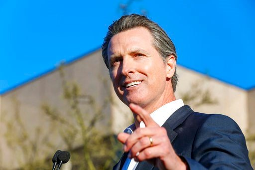 """Lt. Gov. Gavin Newsom speaks at the UTA """"United Voices"""" Rally at UTA headquarters on Friday, Feb. 24, 2017, in Beverly Hills, Calif. (Photo by Willy Sanjuan/Invision/AP)"""