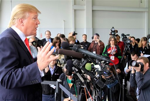 Donald Trump, a possible 2012 presidential candidate, talks to reporters after arriving at the Pease International Tradeport Wednesday, April 27, 2011 in Portsmouth, N.H.