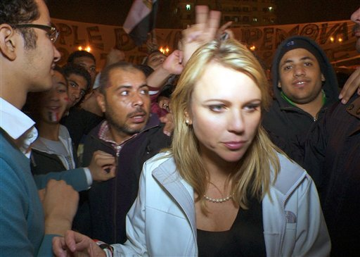 """FILE - In this Feb. 11, 2011 file photo released by CBS, """"60 Minutes"""" correspondent Lara Logan is shown covering the reaction in in Cairo's Tahrir Square the day Egyptian President Hosni Mubarak stepped down."""