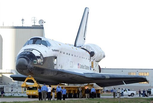 FILE - In this Monday, Feb. 28, 2011 file picture, the space shuttle Endeavour is transported from the Orbital Processing Facility to the Vehicle Assembly Building.
