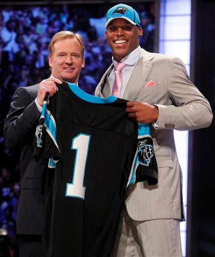 Auburn quarterback Cam Newton, right, holds up a jersey with NFL commissioner Roger Goodell after he was selected as the No. 1 overall pick by the Carolina Panthers in the first round of the NFL football draft at Radio City Music Hall Thursday, April 28,