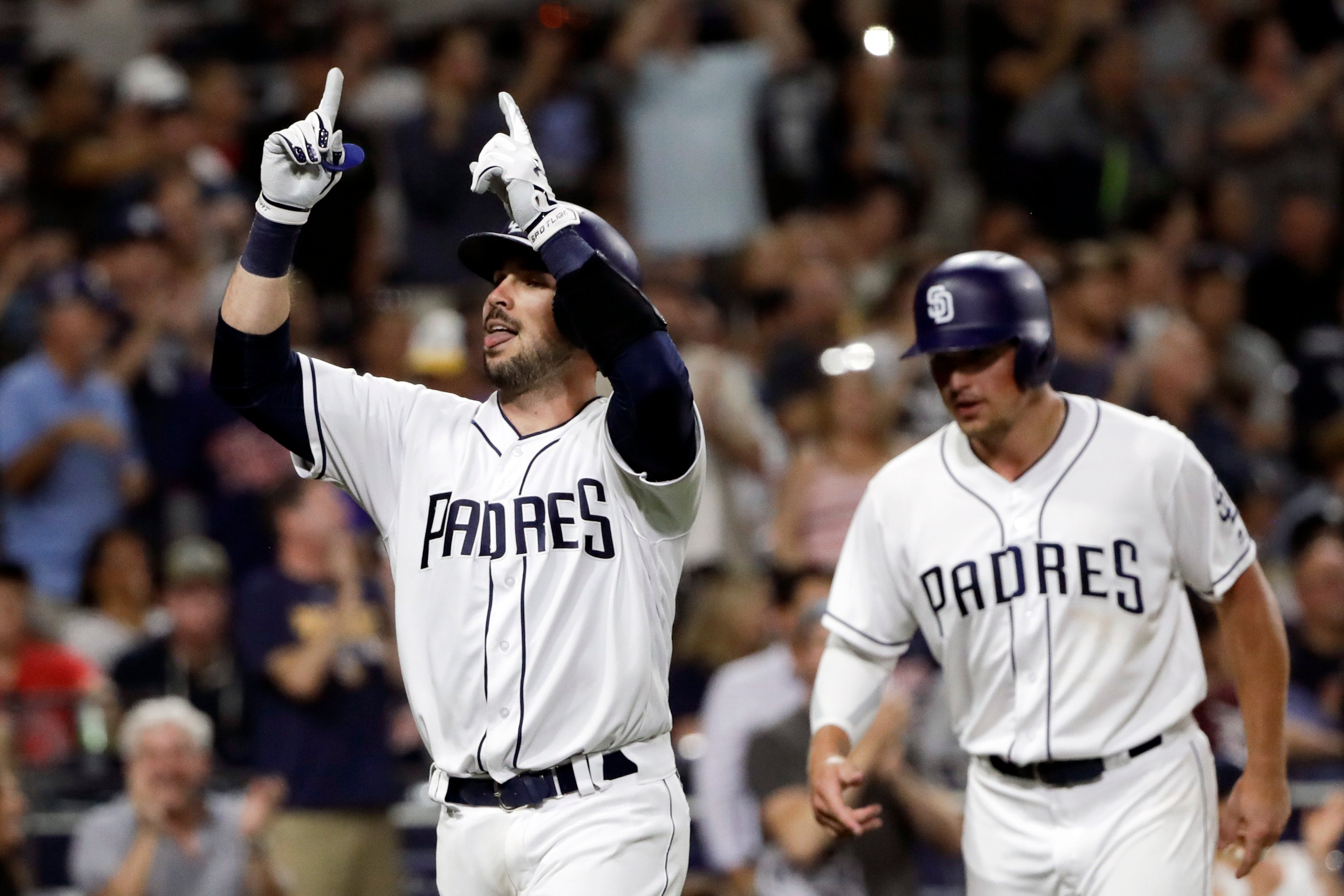 San Diego Padres' Austin Hedges, left, celebrates after hitting two-run home run as teammate Hunter Renfroe, right, follows during the eighth inning of a baseball game against the Minnesota Twins on Tuesday, Aug. 1, 2017, in San Diego. (AP Photo/Gregory B