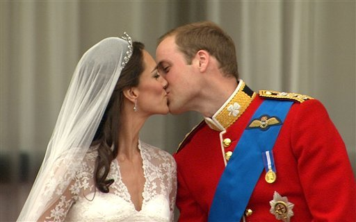 In this image taken from video, Britain's Prince William, right, kisses his wife, Kate, the Dutchess of Cambridge, from the balcony of Buckingham Palace after the Royal Wedding in London on Friday, April, 29, 2011.
