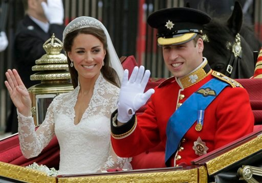 Britain's Prince William and his wife Kate, Duchess of Cambridge, left, wave as they leave Westminster Abbey at the Royal Wedding in London Friday, April, 29, 2011. (AP Photo/Alastair Grant)