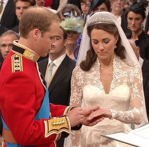 In this image taken from video, Britain's Prince William, left, places the ring on the finger of his bride, Kate Middleton, as they stand at the altar at Westminster Abbey for the Royal Wedding in London on Friday, April, 29, 2011.