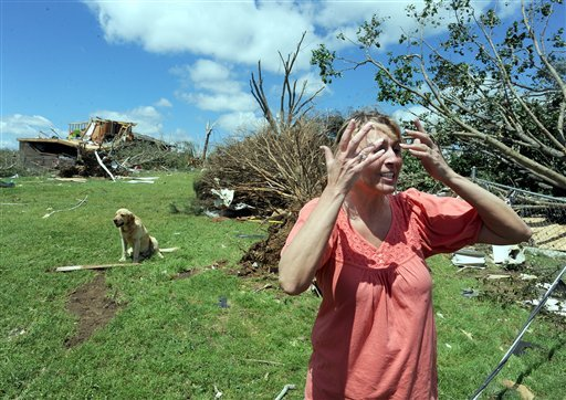Angela Wigley talks about the tornado that destroyed her house in Rainsville, Ala., Thursday, April, 28, 2011. A least 32 people died when a tornado struck Dekalb County Wednesday. (AP Photo/ Birmingham News, Mark Almond)