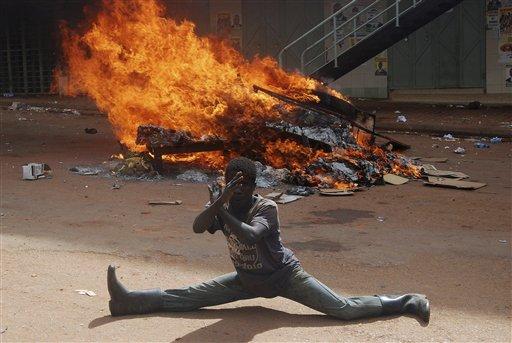 Ugandan protestor burn tyres and wood during demonstration in capital city Kampala, Uganda, Friday, April 29, 2011. (AP Photo / Stephen Wandera)