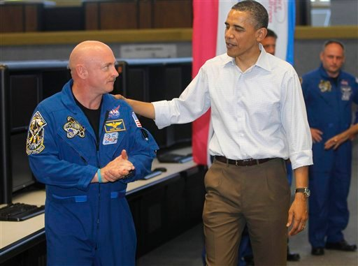 President Barack Obama meets with Space Shuttle Endeavor commander Mark Kelly, husband of wounded Rep. Gabrielle Giffords, D-Ariz., and shuttle astronauts, after their launch was scrubbed, Friday, April 29, 2011, at Kennedy Space Center.