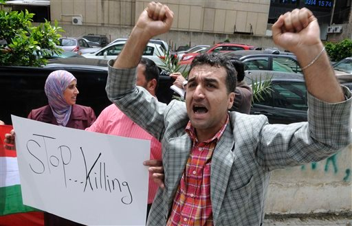 A Syrian Kurdish man shouts anti-government slogans during a protest near the Syrian embassy in Beirut, Lebanon, Friday, April 29, 2011. (AP Photo/Ahmad Omar)
