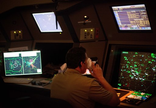 An air traffic controller drinks a cup of coffee while working in a terminal radar approach control room Monday, April 18, 2011 at the Atlanta TRACON in Peachtree City, Ga.