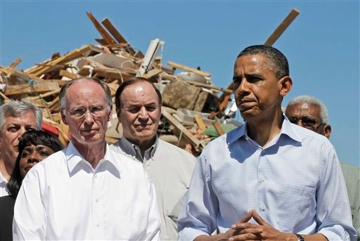President Barack Obama stands with Alabama Gov. Robert Bentley, left, Sen. Richard Shelby, R-Ala., and others, as they toured tornado damage in Tuscaloosa, Ala., Friday, April 29, 2011.