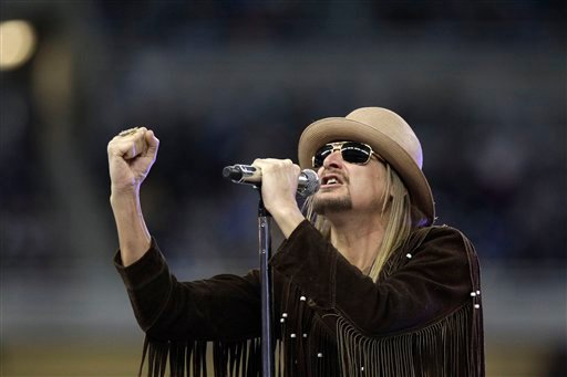 This Nov. 25, 2010 file photo shows musician Kid Rock performing during the half time ceremony at the NFL football game between the Detroit Lions and the New England Patriots at Ford Field in Detroit.