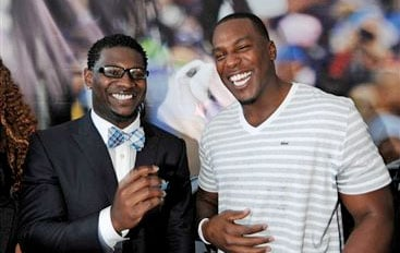 Former San Diego Chargers running back LaDainian Tomlinson, left, jokes around with Chargers tight end Antonio Gates during a news conference at the team's facility, Monday, June 18, 2012, in San Diego.