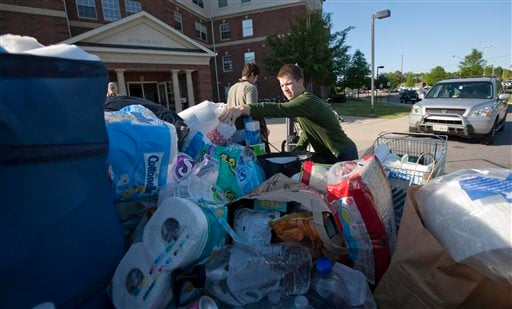 University of Alabama student David Brock of Chattanooga, Tenn., loads up a pickup truck full of student donated supplies for tornado victims in Tuscaloosa, Ala., Friday, April 29, 2011. (AP Photo/Dave Martin)