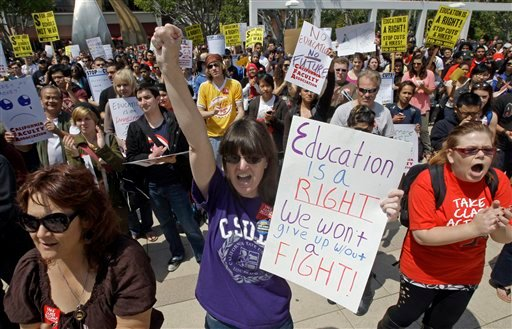 Elaine Nadalin, center, a junior who says it will take her 6 years to graduate, joins several hundred college students, faculty and staff protesting the state budget at California State University Long Beach April 13, 2011. (AP Photo/Reed Saxon)