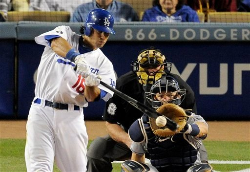 LA Dodgers' Andre Ethier hits a single as San Diego Padres catcher Nick Hundley and home plate umpire Bob Davidson look on during the eighth inning of their Major League Baseball game April 30, 2011 in LA. (AP Photo/Mark J. Terrill)
