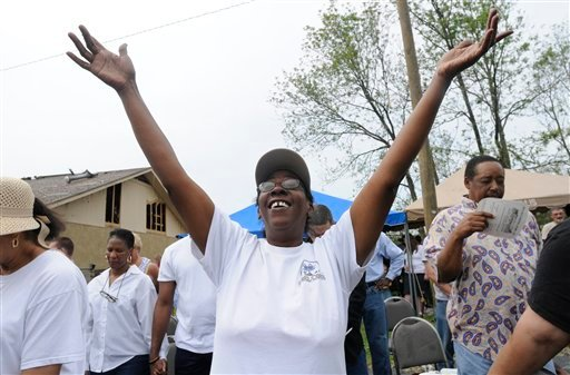 Jean Croft worships at an outdoor service at Mt. Peria Baptist Church in Ringgold, Ga. Sunday, May 1, 2011 after thke church was damaged by a tornado on Wednesday night. (AP Photo/Billy Weeks)