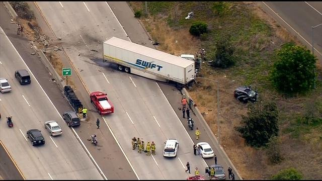 Two dead, child hurt in big rig crash on SR-125