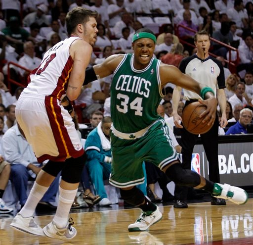 Boston Celtics' Paul Pierce drives to he basket as Miami Heat's Mike Miller defends during the first half of Game 1 of a second-round NBA playoff basketball series, Sunday, May 1, 2011, in Miami. (AP Photo/Jeffrey M. Boan)