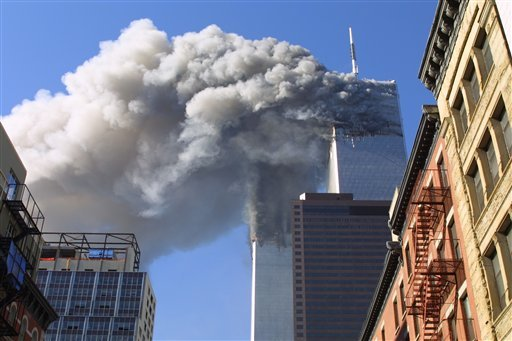 FILE - In this Sept. 11, 2001 file photo, the twin towers of the World Trade Center burn after hijacked planes crashed into them in New York. A person familiar with developments said Sunday, May 1, 2011 that Osama bin Laden is dead.