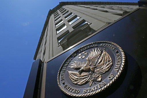 FILE - In this June 21, 2013, file photo, the seal affixed to the front of the Department of Veterans Affairs building in Washington.(AP Photo/Charles Dharapak, File)