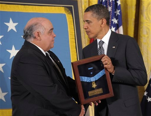 President Barack Obama awards posthumous the Medal of Honor to George Kaho'ohanohano, nephew of Pfc. Anthony T. Kaho'ohanohano , during a ceremony in the East Room of the White House in Washington, Monday, May 2, 2011.