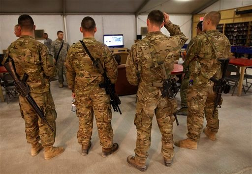 United States military troops watch breaking news on the announcement by President Barack Obama that Osama bin Laden had been killed, at the USO at Kandahar Airfield, southern Afghanistan.