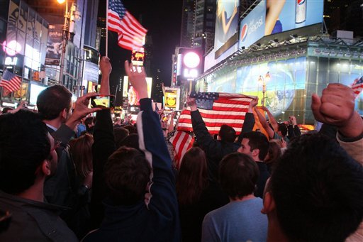 A crowd gathered in New York's Times Square reacts to the news of Osama Bin Laden's death early Monday morning May 2, 2011.