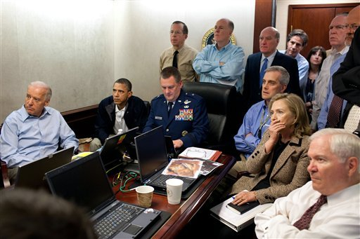 Secretary of State Hillary Rodham Clinton, President Barack Obama and Vice President Joe Biden, along with with members of the national security team, receive an update on the mission against Osama bin Laden in the Situation Room of the White House.