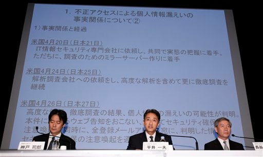 Sony Computer Entertainment President and CEO Kazuo Hirai, center, speaks as Sony Corp.'s Senior Vice Presidents Shiro Kambe, left, and Shinji Hasejima, right, listen during a press conference at the Sony Corp. headquarters in Tokyo Sunday, May 1, 2011.