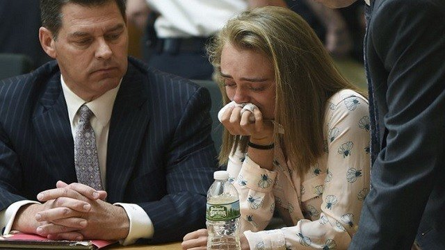 Michelle Carter cries while flanked by defense attorneys Joseph Cataldo, left, and Cory Madera, after being found guilty of involuntary manslaughter in the suicide of Conrad Roy III.